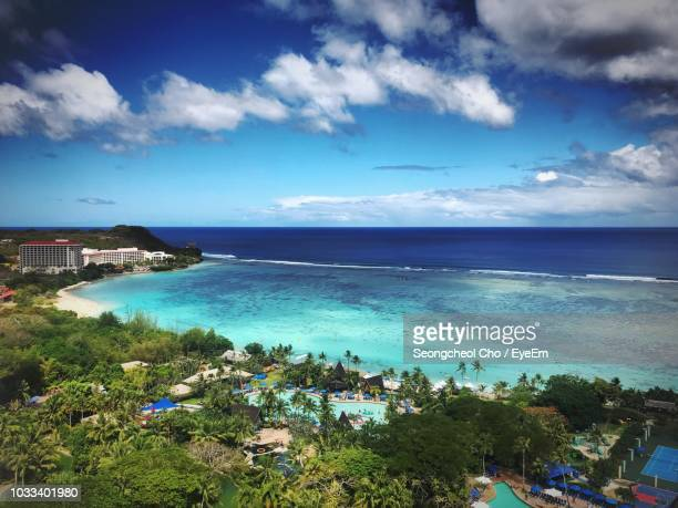 scenic view of beach against sky - guam stock pictures, royalty-free photos & images
