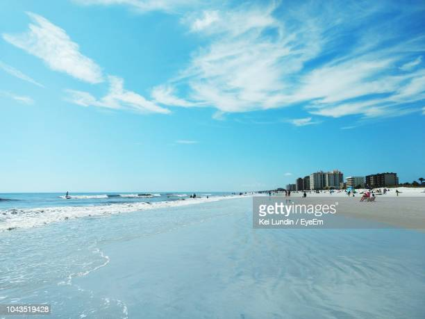 scenic view of beach against sky - jacksonville beach florida stock pictures, royalty-free photos & images