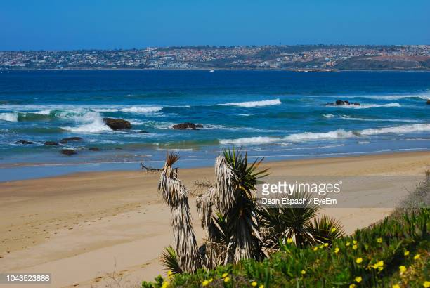 scenic view of beach against sky - mossel bay stock pictures, royalty-free photos & images