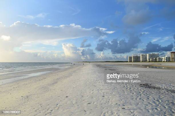 scenic view of beach against sky - marco island stock pictures, royalty-free photos & images