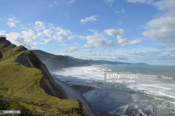 scenic view of beach against sky - iñaki mt stock photos and pictures
