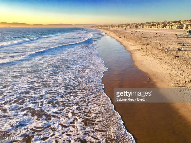 scenic view of beach against sky - hermosa beach stock pictures, royalty-free photos & images