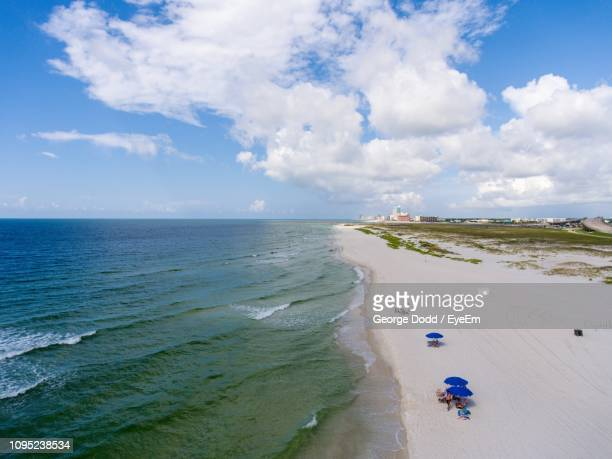 scenic view of beach against sky - gulf coast states stock pictures, royalty-free photos & images