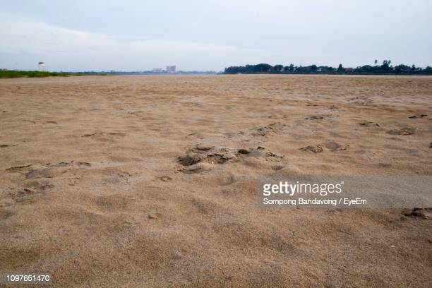 scenic view of beach against sky - land feature stock pictures, royalty-free photos & images