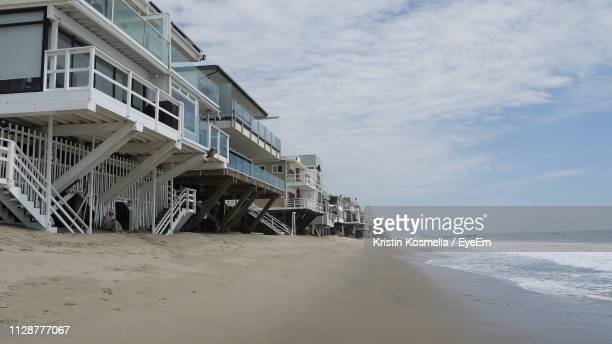scenic view of beach against sky - malibu beach stock pictures, royalty-free photos & images