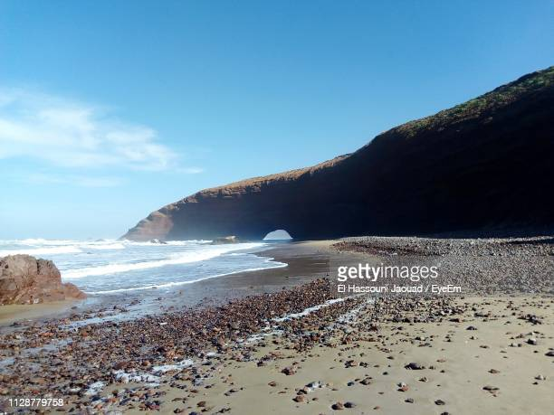 scenic view of beach against sky - agadir stock pictures, royalty-free photos & images