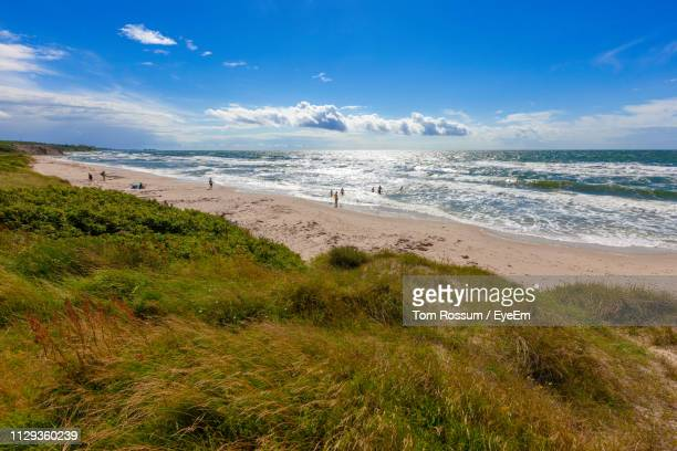 scenic view of beach against sky - coastal feature stock pictures, royalty-free photos & images