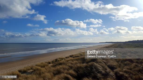 scenic view of beach against sky - cumulus stock pictures, royalty-free photos & images