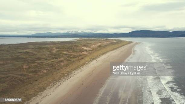 scenic view of beach against sky - inch stock pictures, royalty-free photos & images