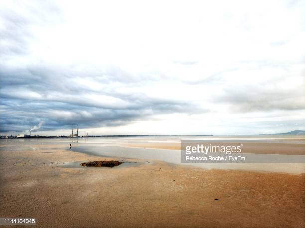 scenic view of beach against sky - blackrock stock pictures, royalty-free photos & images