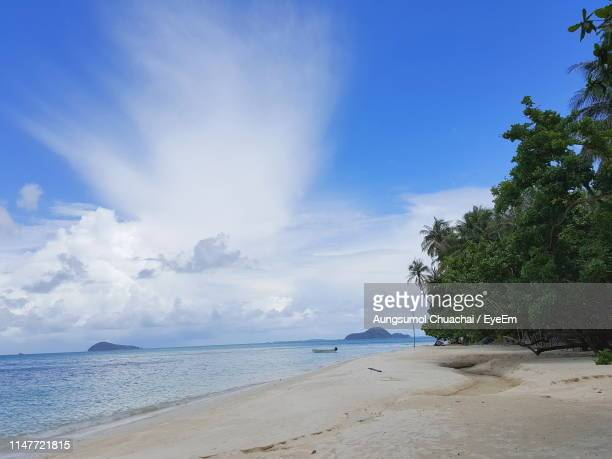 scenic view of beach against sky - aungsumol stock pictures, royalty-free photos & images