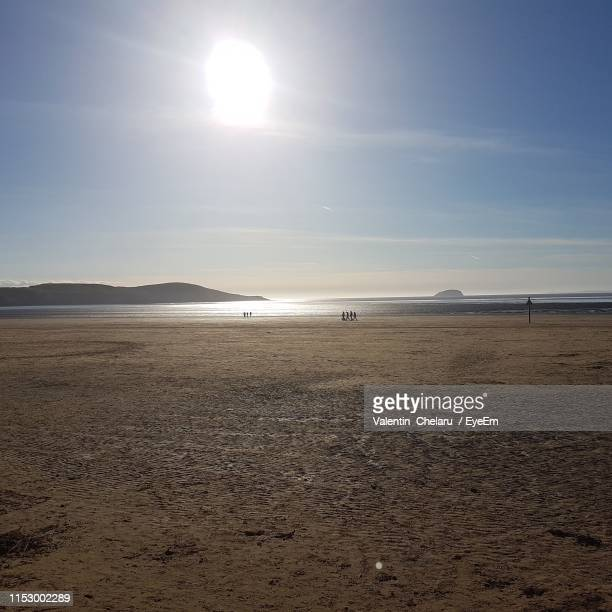 scenic view of beach against sky - weston super mare stock pictures, royalty-free photos & images