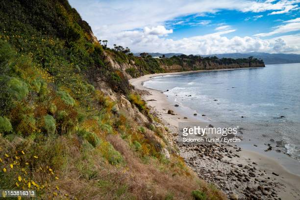 scenic view of beach against sky - solomon turkel stock pictures, royalty-free photos & images