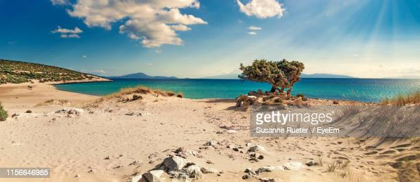 scenic view of beach against sky - naxos stockfoto's en -beelden
