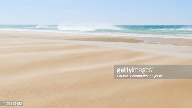 scenic view of beach against sky - claudia romanazzo foto e immagini stock