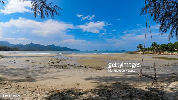 scenic view of beach against sky - thai mueang photos et images de collection