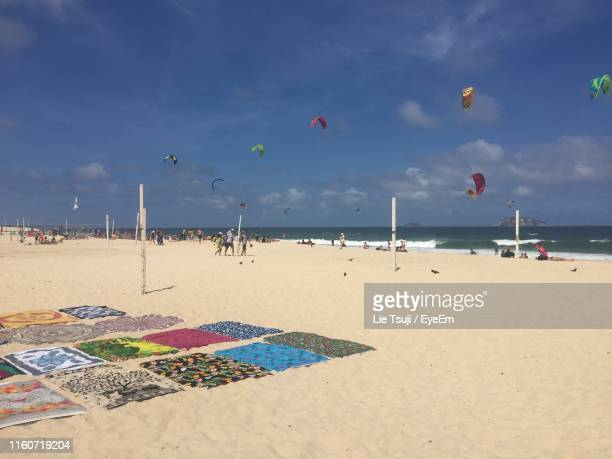 scenic view of beach against sky - praia stock pictures, royalty-free photos & images