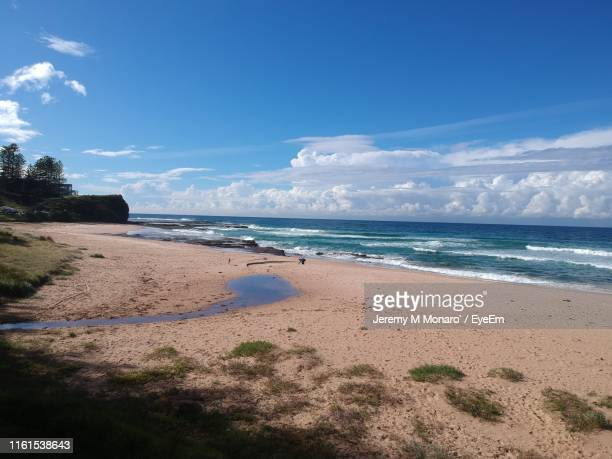 scenic view of beach against sky - jeremy monaro stock pictures, royalty-free photos & images