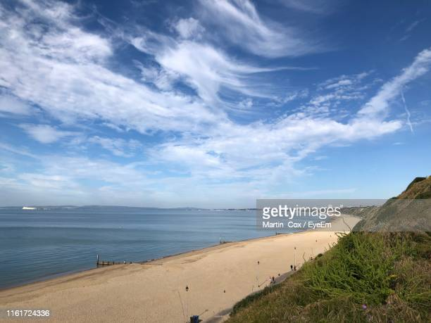 scenic view of beach against sky - bournemouth england stock pictures, royalty-free photos & images
