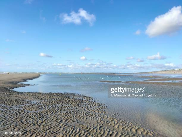 scenic view of beach against sky - somme stock pictures, royalty-free photos & images