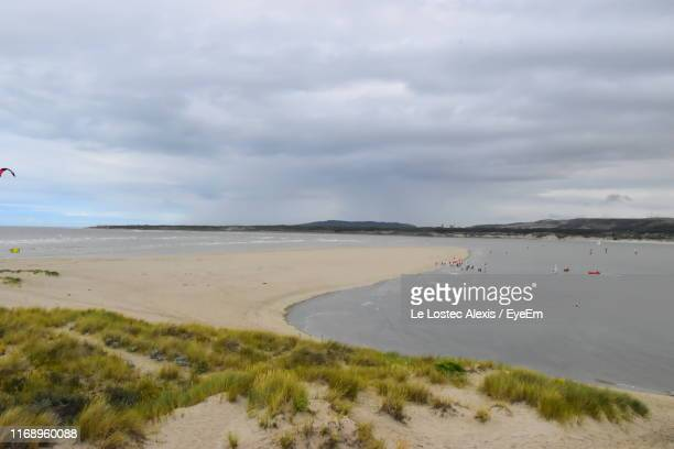 scenic view of beach against sky - le touquet paris plage stock pictures, royalty-free photos & images