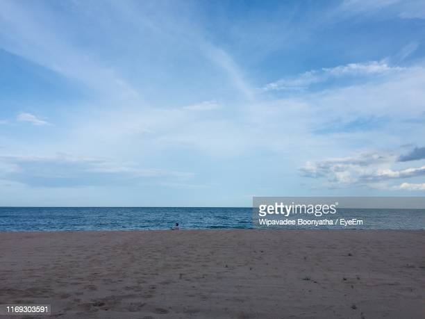 scenic view of beach against sky - wipavadee stock photos and pictures