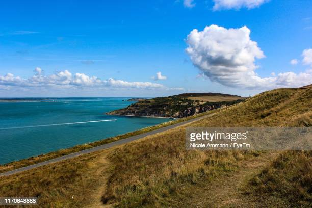 scenic view of beach against sky - isle of wight stock pictures, royalty-free photos & images