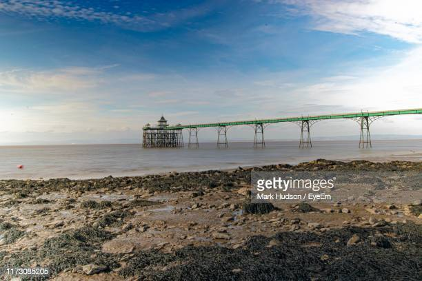 scenic view of beach against sky - clevedon pier stock pictures, royalty-free photos & images