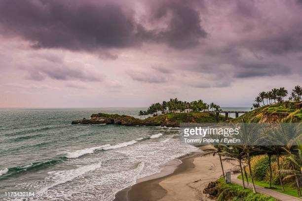 scenic view of beach against sky - pacific ocean stock pictures, royalty-free photos & images