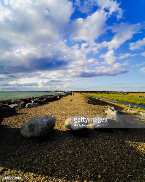 scenic view of beach against sky - andy rinkoff stock photos and pictures