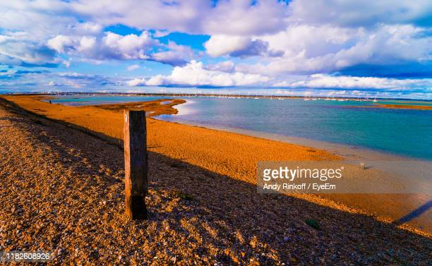 scenic view of beach against sky - andy rinkoff stock pictures, royalty-free photos & images