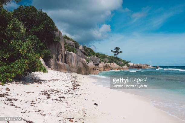 scenic view of beach against sky - bortes stock pictures, royalty-free photos & images