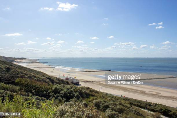 scenic view of beach against sky - zeeland stock pictures, royalty-free photos & images