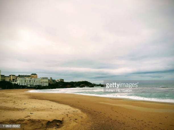 scenic view of beach against sky - biarritz stock pictures, royalty-free photos & images