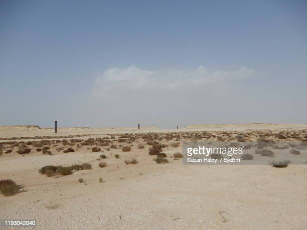 scenic view of beach against sky - qatar stock pictures, royalty-free photos & images