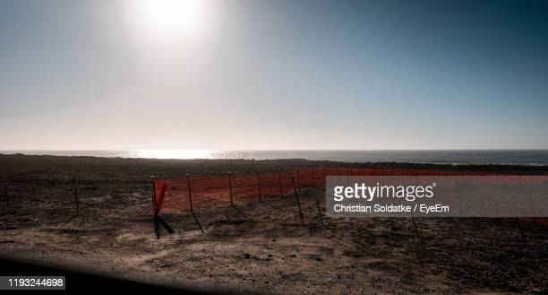 scenic view of beach against sky - christian soldatke imagens e fotografias de stock