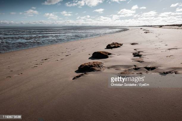 scenic view of beach against sky - christian soldatke stock pictures, royalty-free photos & images