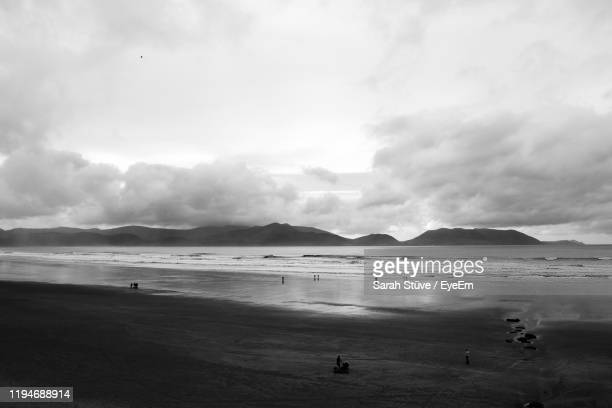 scenic view of beach against sky - sarah sands stock pictures, royalty-free photos & images