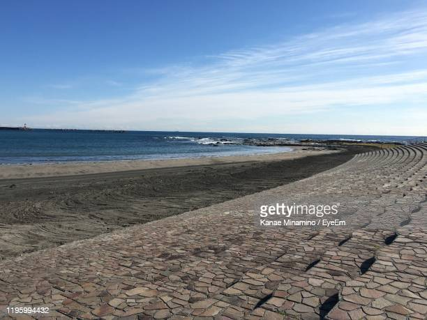 scenic view of beach against sky - minamino stock pictures, royalty-free photos & images