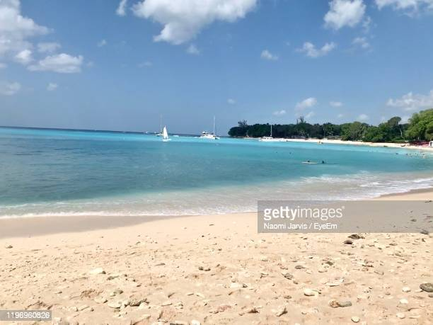scenic view of beach against sky - naomi jarvis stock pictures, royalty-free photos & images