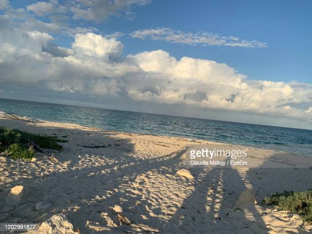 scenic view of beach against sky - sandy molloy stock pictures, royalty-free photos & images