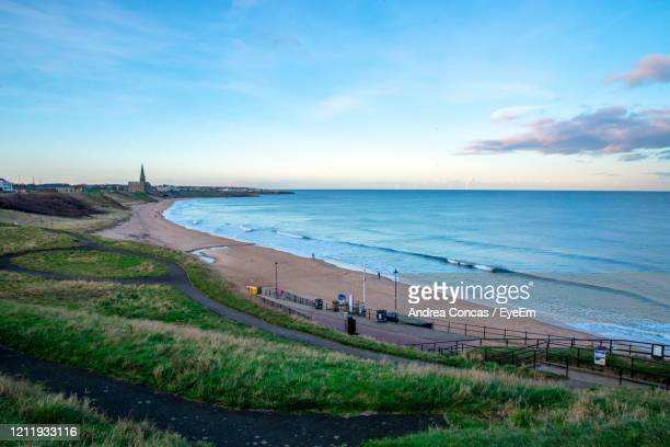 scenic view of beach against sky - sunderland stock pictures, royalty-free photos & images