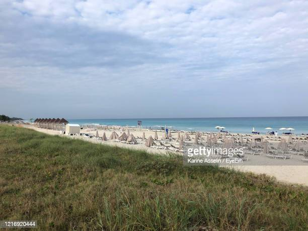 scenic view of beach against sky - karine asselin stock pictures, royalty-free photos & images
