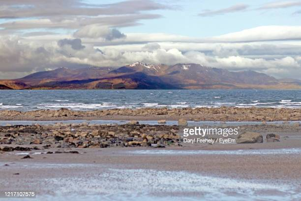scenic view of beach against sky - strathclyde stock pictures, royalty-free photos & images