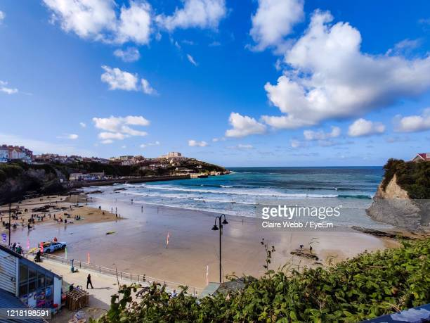 scenic view of beach against sky - newquay stock pictures, royalty-free photos & images