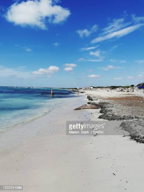 scenic view of beach against sky - majorca stock pictures, royalty-free photos & images