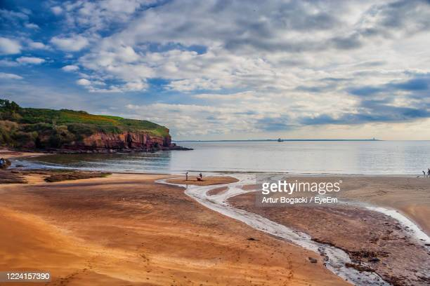 scenic view of beach against sky - county waterford ireland stock pictures, royalty-free photos & images