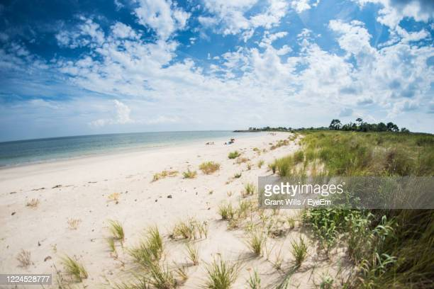 scenic view of beach against sky - chesapeake bay stock pictures, royalty-free photos & images