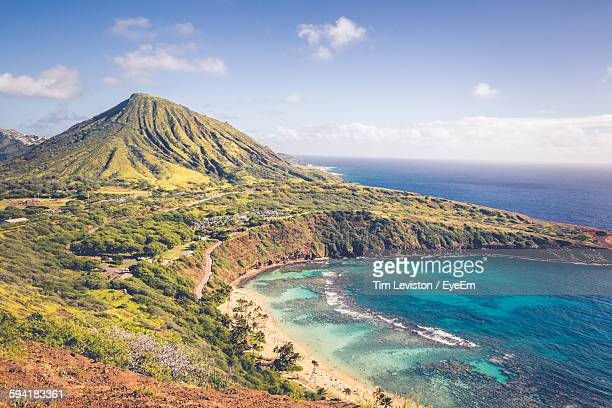 scenic view of beach against sky - honolulu stock pictures, royalty-free photos & images