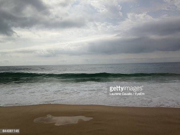 scenic view of beach against sky - biscarrosse photos et images de collection